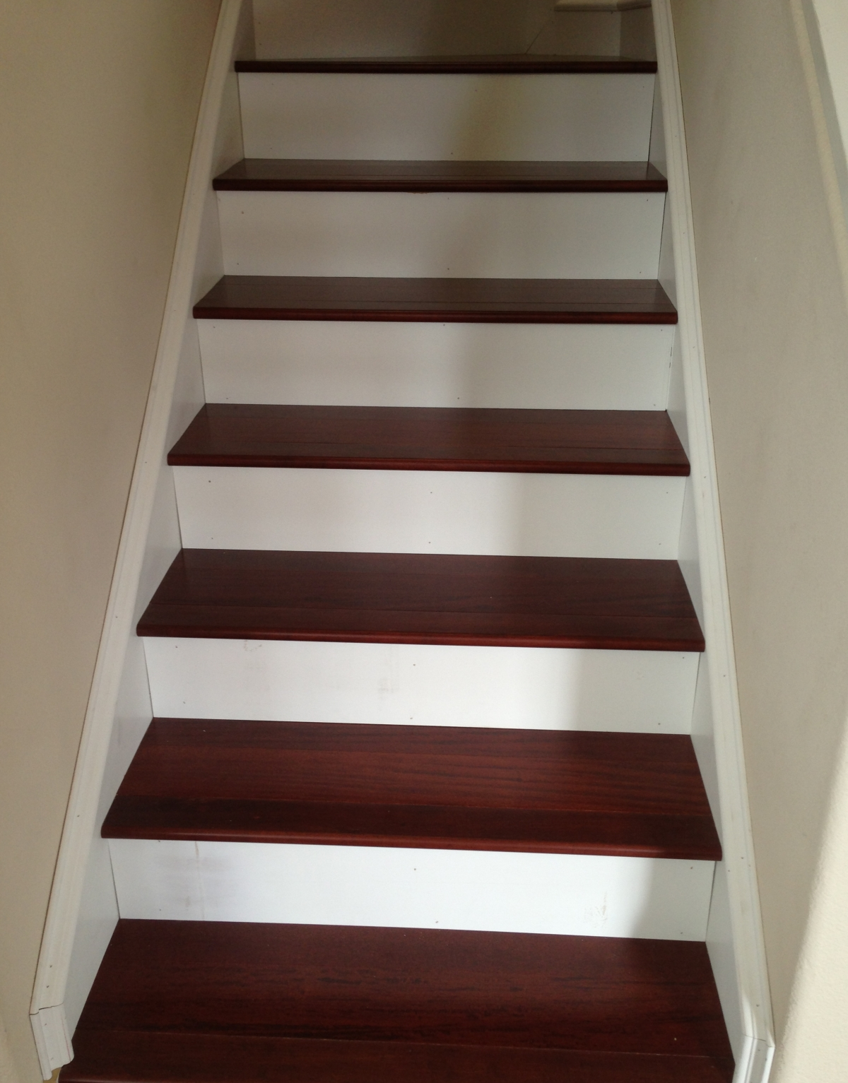 Engineered Wood Stairs With White Paneling Riser