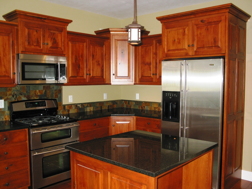 Kitchen remodeling cherry wood kitchen cabinets black granite counters cidar construction - Kitchen remodel designs ...